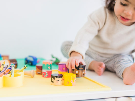 Little boy playing with MyFamilyBuilders Wooden Toys