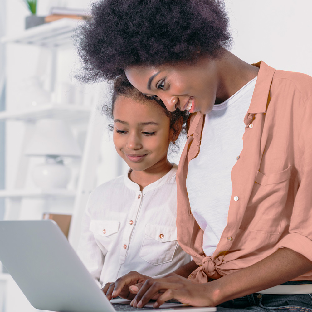 mother with child ordering wholesale goods on laptop